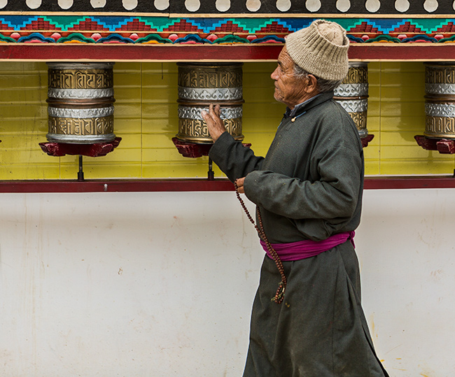 Old man spinning the Prayer Wheel at the Chokhang Vihara Gompa, Leh, Ladakh, India