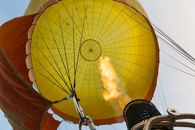 Blasting hot air into the hot air balloon