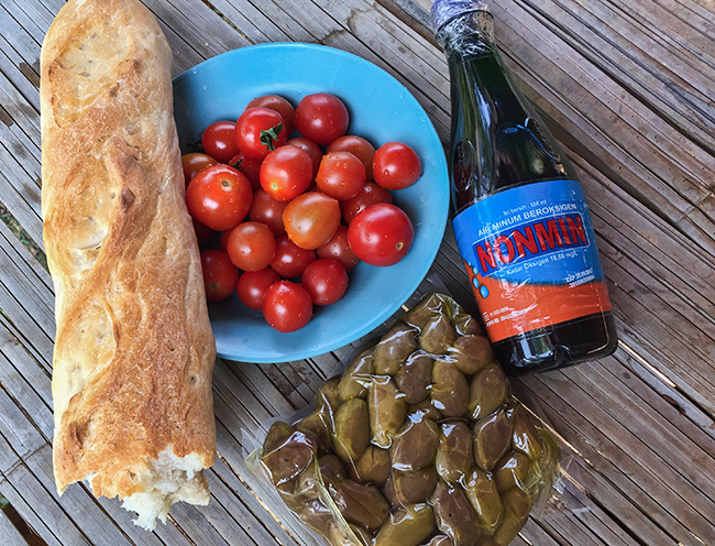 Greek olives and olive oil with Thai tomatoes and French bread