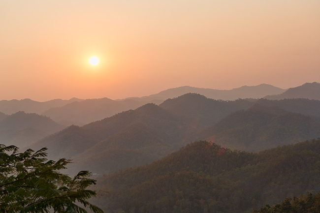 Sunset over the mountains toward Myanmar