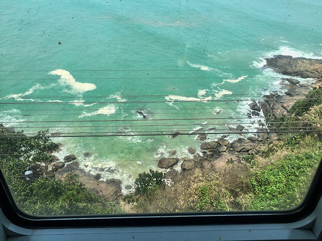 The ocean outside of the train window