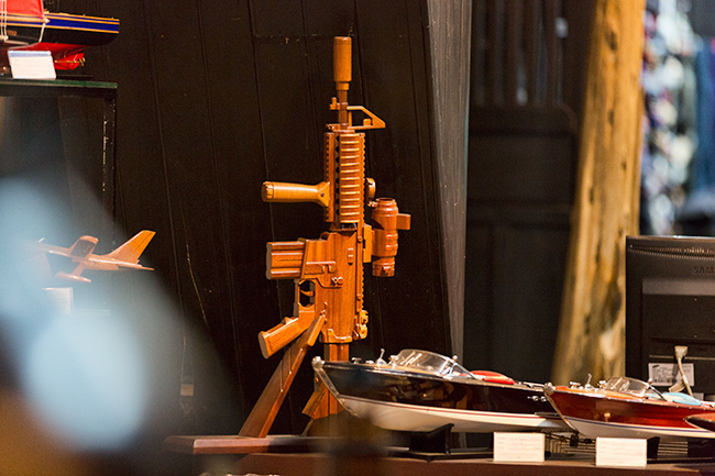 Who would bring this home?? A wooden gun for the living room?